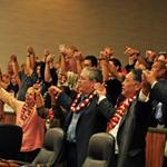"County Council and audience members singing ""Hawaii Aloha"""